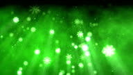 Snow flakes christmas background in green video