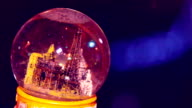 Snow globe on the dark background video