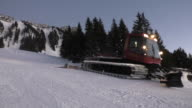 Snow groomer, snow cat in Action during sunset video