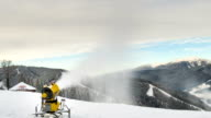 Snow machine gun on a ski slope. Timelapse video