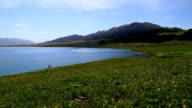 snow mountains and Sayram Lake video