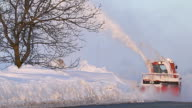 Snow truck cleaning snow from the road and streets working in snowy day video