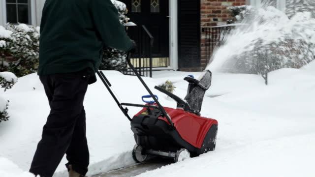 Snowblower Clearing Sidewalk in Winter (Video) video