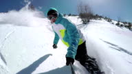 SLOW MOTION: Snowboarder carving in fresh powder snow off piste video
