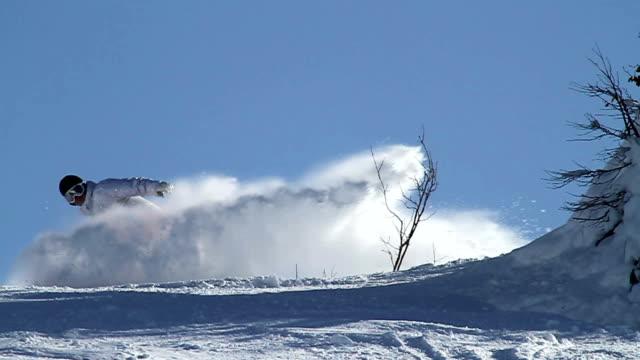 Snowboarder does a snow spray video