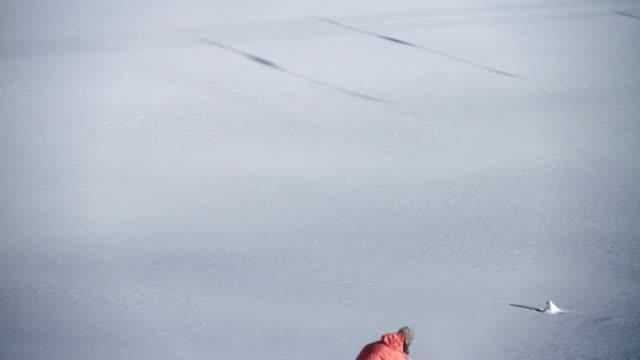 Snowboarder does fresh powder turn video