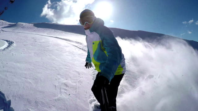Snowboarder doing hand drags and powder turns in fresh snow video
