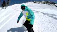SLOW MOTION CLOSEUP: Snowboarder doing powder turns in fresh snow video
