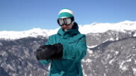 Snowboarder girl putting on gloves video