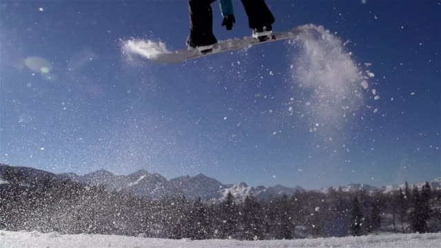 SLOW MOTION: Snowboarder jumping a kicker video