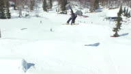 AERIAL: Snowboarder jumping big air kicker video