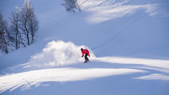 Snowboarder powder snow turn video