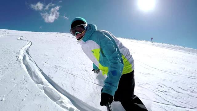 SLOW MOTION SELFIE: Snowboarder riding fresh snow doing powder turns video