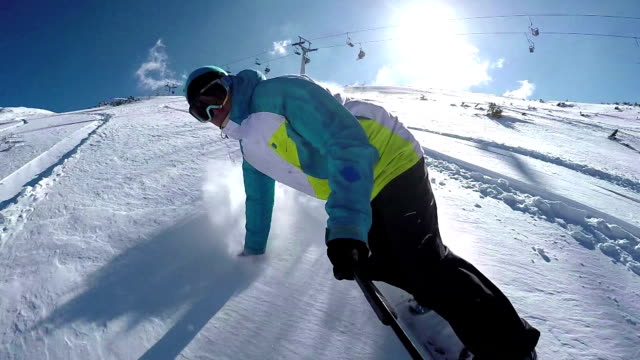SLOW MOTION: Snowboarder riding powder snow in ski resort video