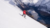 Snowboarder riding some freshly fallen snow with fjord in background video