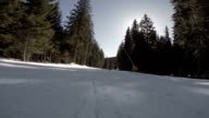 Snowboarder sliding down the hill, white snow mountains snowboarding on slopes video