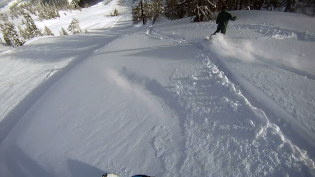 Snowboarders riding powder video