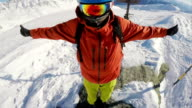 snowboarding bgetting ready to dropp of a mountain top video