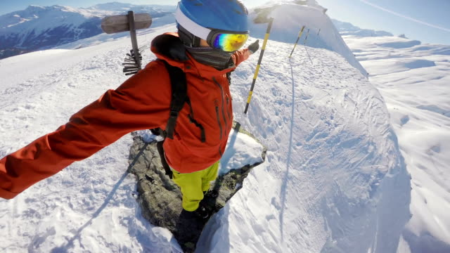 snowboarding standing on a hill top video