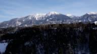 AERIAL: Snow-capped mountain behind a hill video
