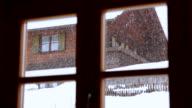 Snowfall behind window video