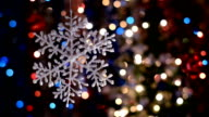 Snowflake decorations, bokeh background, out of focus lights, Christmas and Happy New Year defocused abstract background. video
