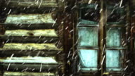 Snowing against the window and wall of an old wooden house. video
