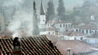 Snowing and smoke in the chimney in Şirince village video
