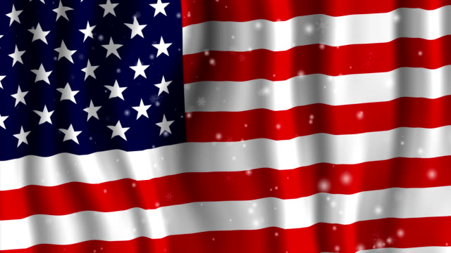 Snowing over USA Stars and Stripes Flag video