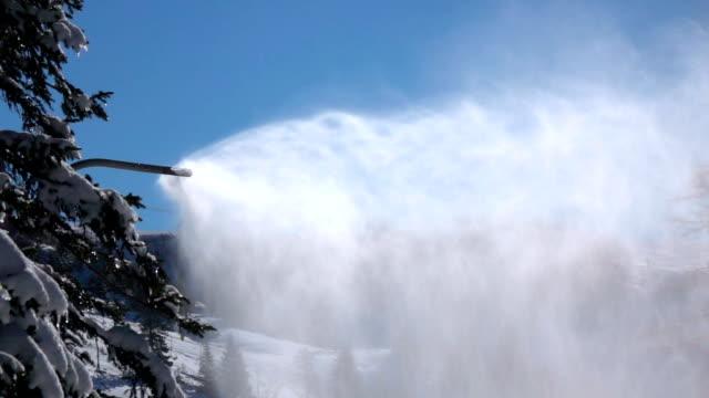 SLOW MOTION: Snowmaking in the mountain ski resort, spraying snow on ski slopes video