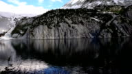 Snowmass Lake Aspen Wilderness Area with Huge Rock Cliffs and amazing Reflection of Alpine Tundra and High Altitude Peaks in Rocky Mountains video