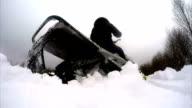 Snowmobile starts in a snowy field video