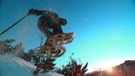 SLO MO Snowshoe jump at sunset video