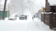 Snowstorm and snow covered streets of the town. Ukraine. video
