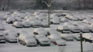 Snowstorm parking lot. Two shots. video