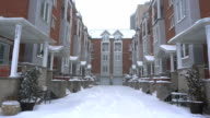 Snowy alley between townhouses in the city. video