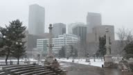 Snowy Civic Center Park with Downtown Denver skyline Colorado winter video
