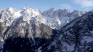 AERIAL: Snowy mountain peaks in afternoon sunlight video