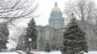 Snowy park with Denver Colorado State Capitol Building in winter video