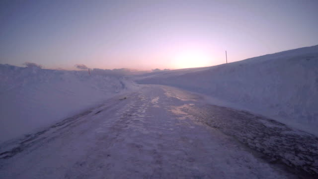 Snowy winter road drive at dusk video