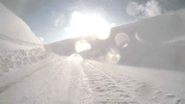 Snowy winter road drive to the sun video
