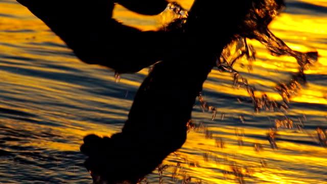 Soaking hands in water video