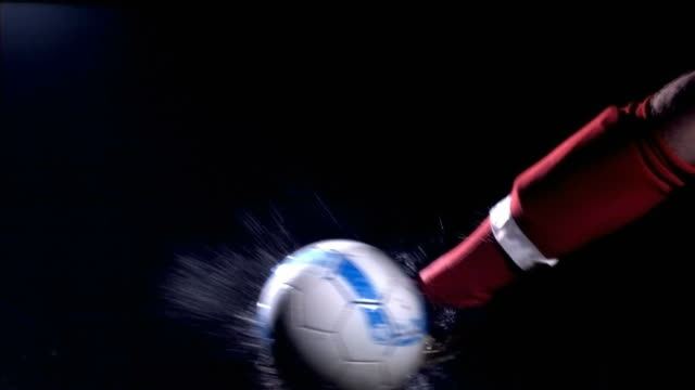 Soccer ball kick, slow motion video
