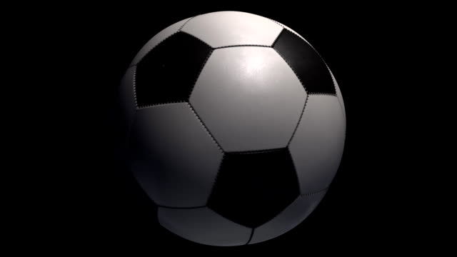 Soccer Ball zoom and turning on black background with alpha. video