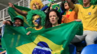 Soccer fans cheering brazil but feeling disappointed because they missed video