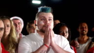 Soccer / Football Fan, supporter praying then cheering goal (Sport) video