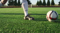 A soccer player does some fancy footwork and opponents slide tackle him video