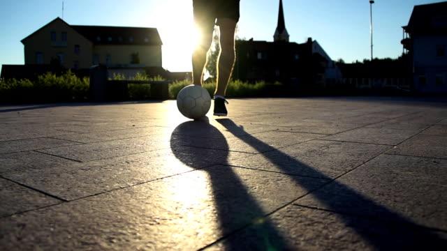 HD SUPER SLOW-MO: Soccer Player Dribbling A Ball video