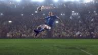 Soccer player kicking ball in stadium video