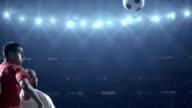 Soccer players kicking ball in stadium video